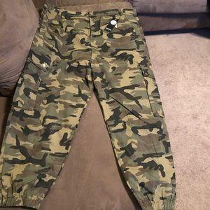 77038349fa5 Boohoo Pants - Boohoo plus size camo skinny jeans